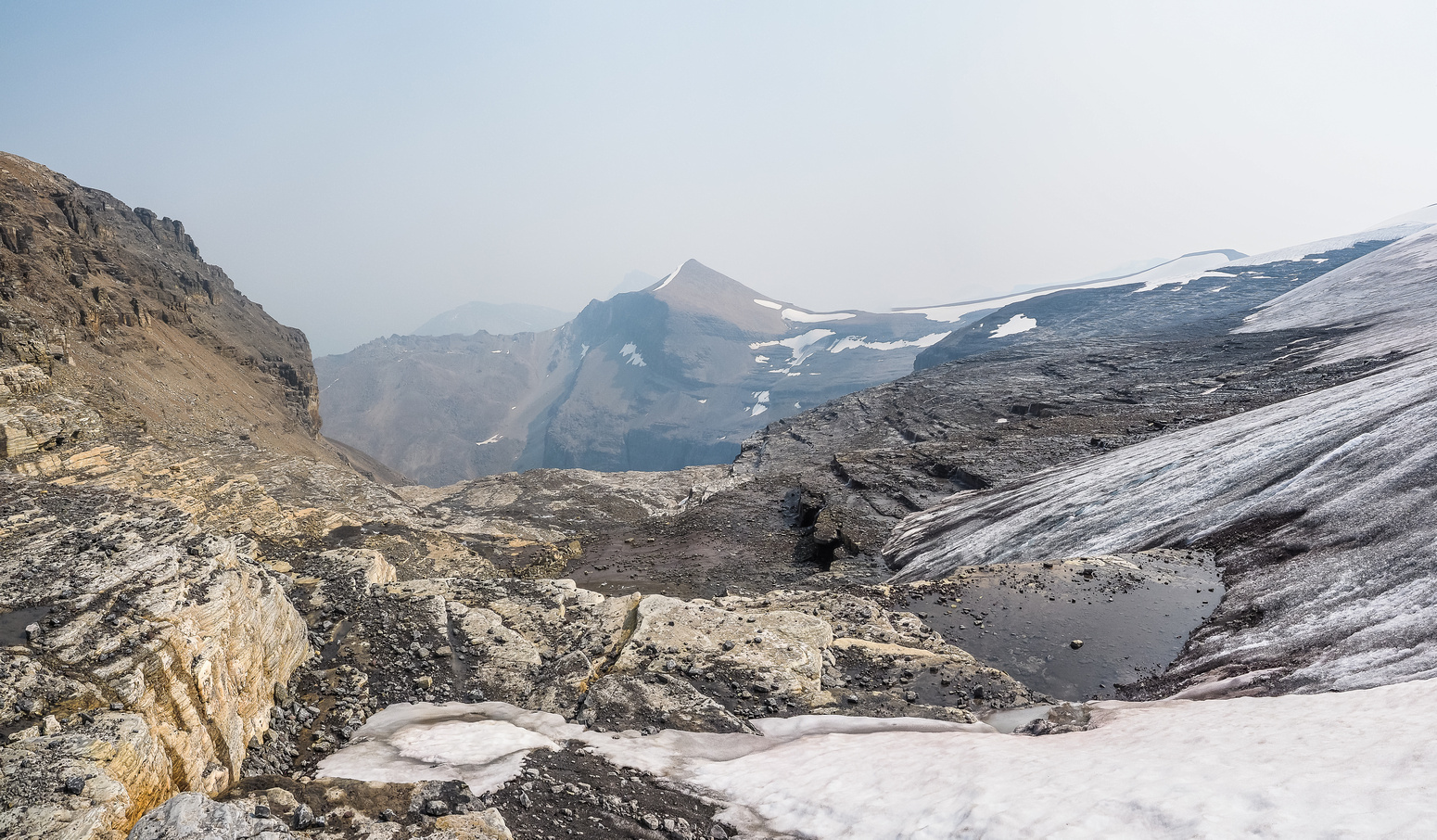 Sitting on the edge of the glacier, looking towards Conical Peak.