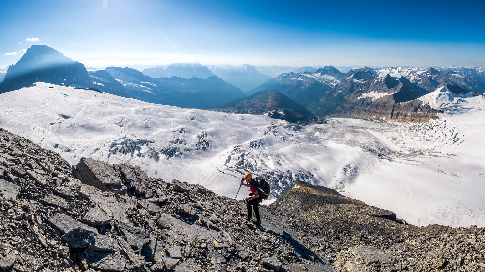 Ferenc ascends easy terrain on the south ridge with incredible views of Mount Columbia to the south and the Chess Group to the southwest.