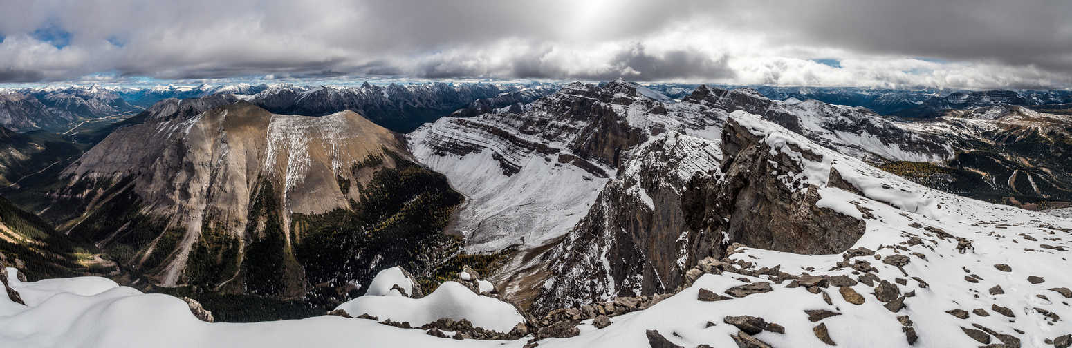 Pretty good views looking north (L) and south (R) include Howard Douglas right of center. The peak at left foreground is unnamed.