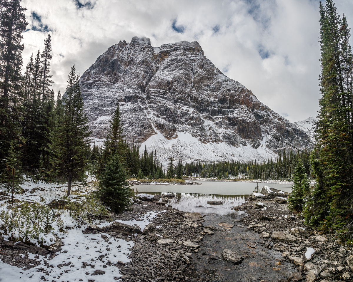 Cathedral Lakes are almost completely frozen - Odaray rises over them dramatically.