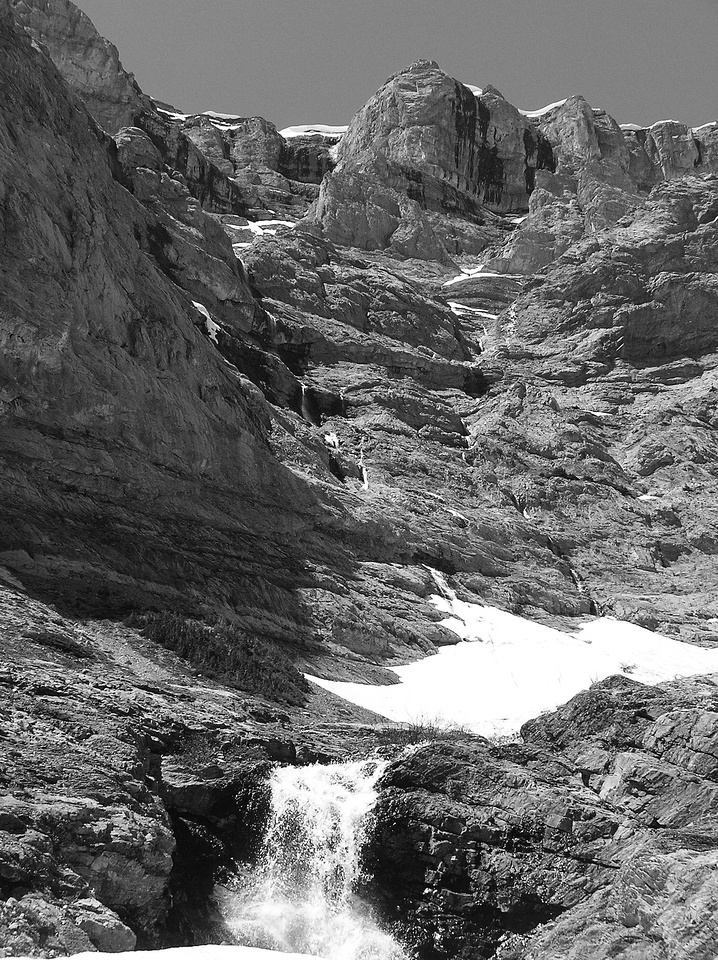 Many waterfalls in the upper bowl, feeding into the Kananaskis River far below.