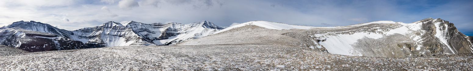 We popped out on the summit plateau to BRUTAL, hurricane force wind but great views! The summit is on the right.