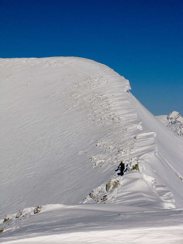 Looking back at Raf and the north summit of Olive. The tricky section is just behind him.