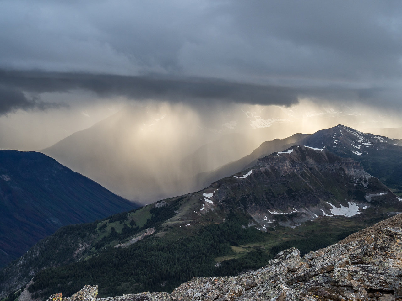 Dramatic back lighting on the storm from the setting sun over Citadel Peak.