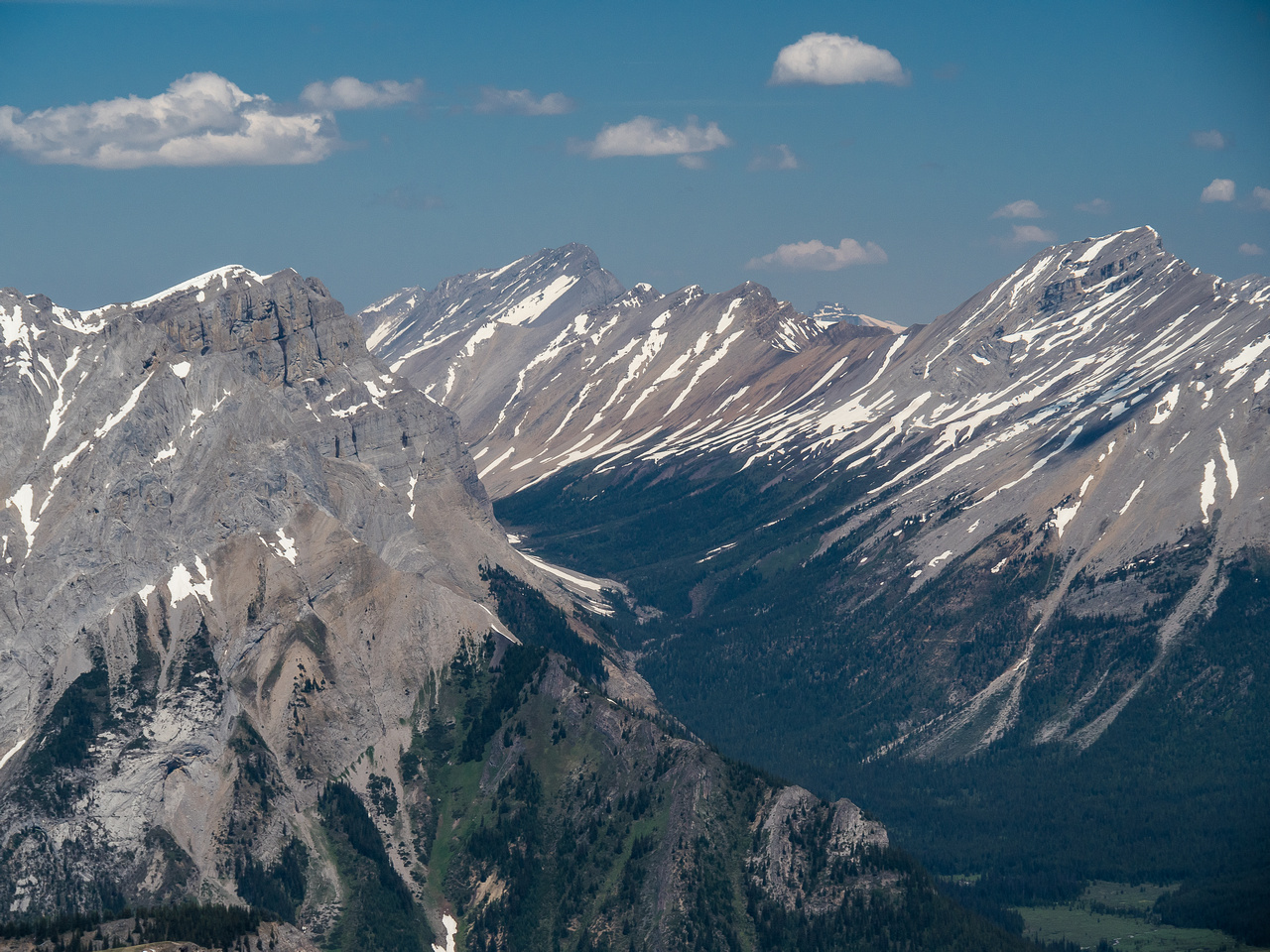 Looking past Cave Mountain and Mount Cautley on the left, up Assiniboine Pass with Og Mountain and Naswald in the distance.