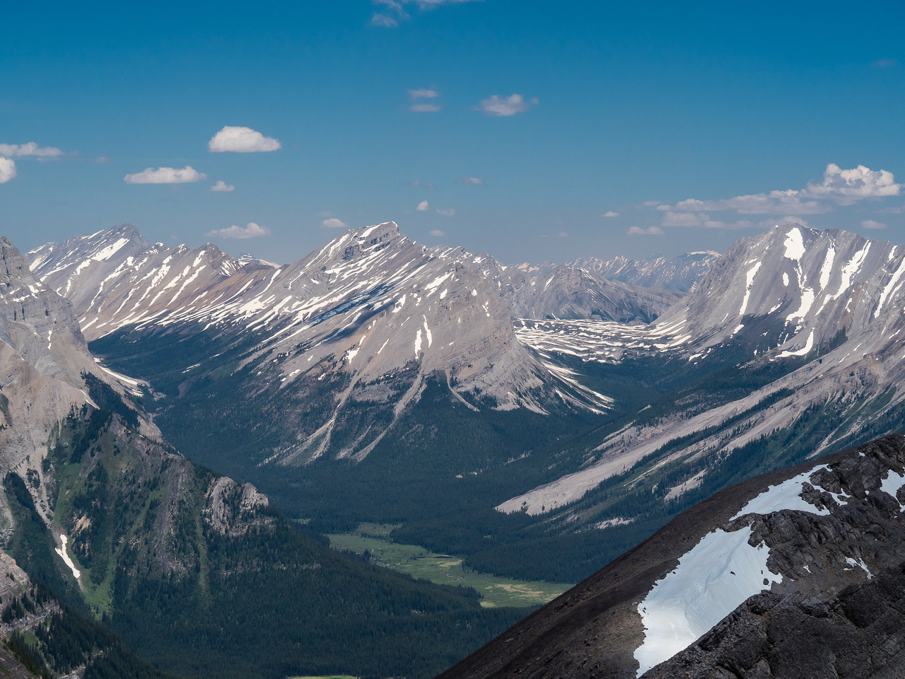 A wider shot toward Mount Mercer and Allenby showing Allenby Pass at right and Assiniboine Pass at left.