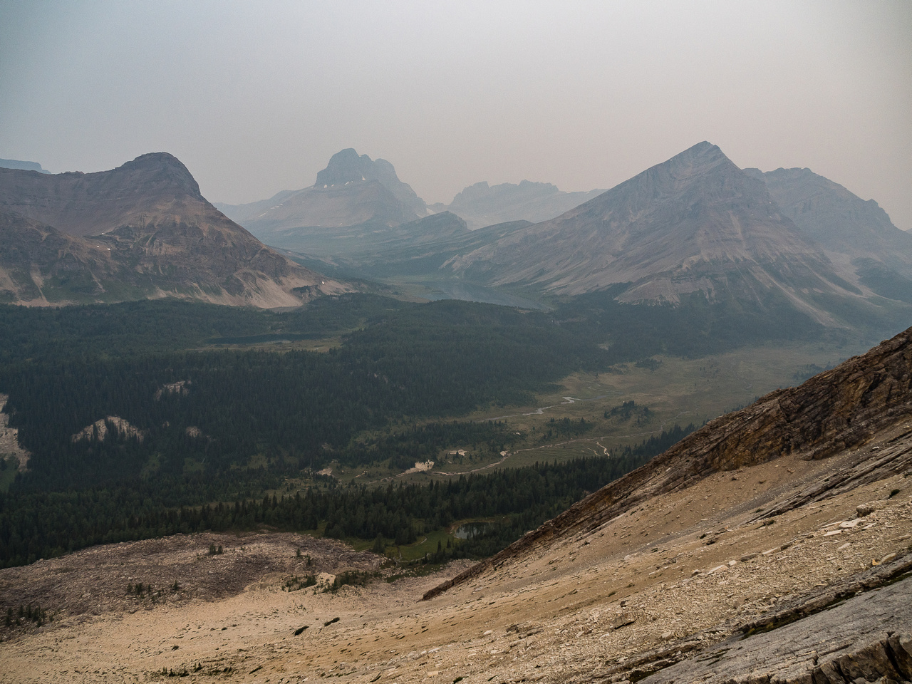 Smokey views past Brachiopod over Baker Lake towards Ptarmigan looming over Packers and Deception Passes. Fossil Mountain at right.
