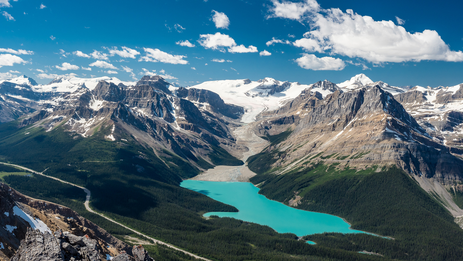 An unusual view of Peyto Lake with the Peyto Glacier draining into it.