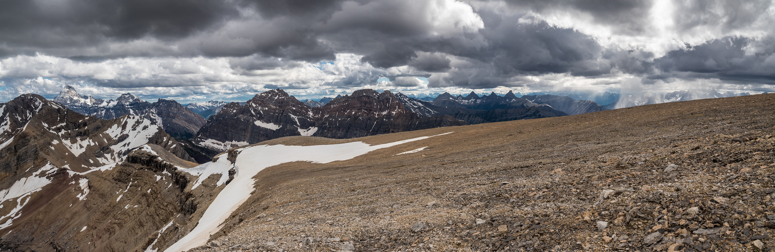 Interesting weather as we pop over the summit plateau to great views of Assiniboine (L) to Indian Peak (C) and towards Selkirk and Split Peak (R).