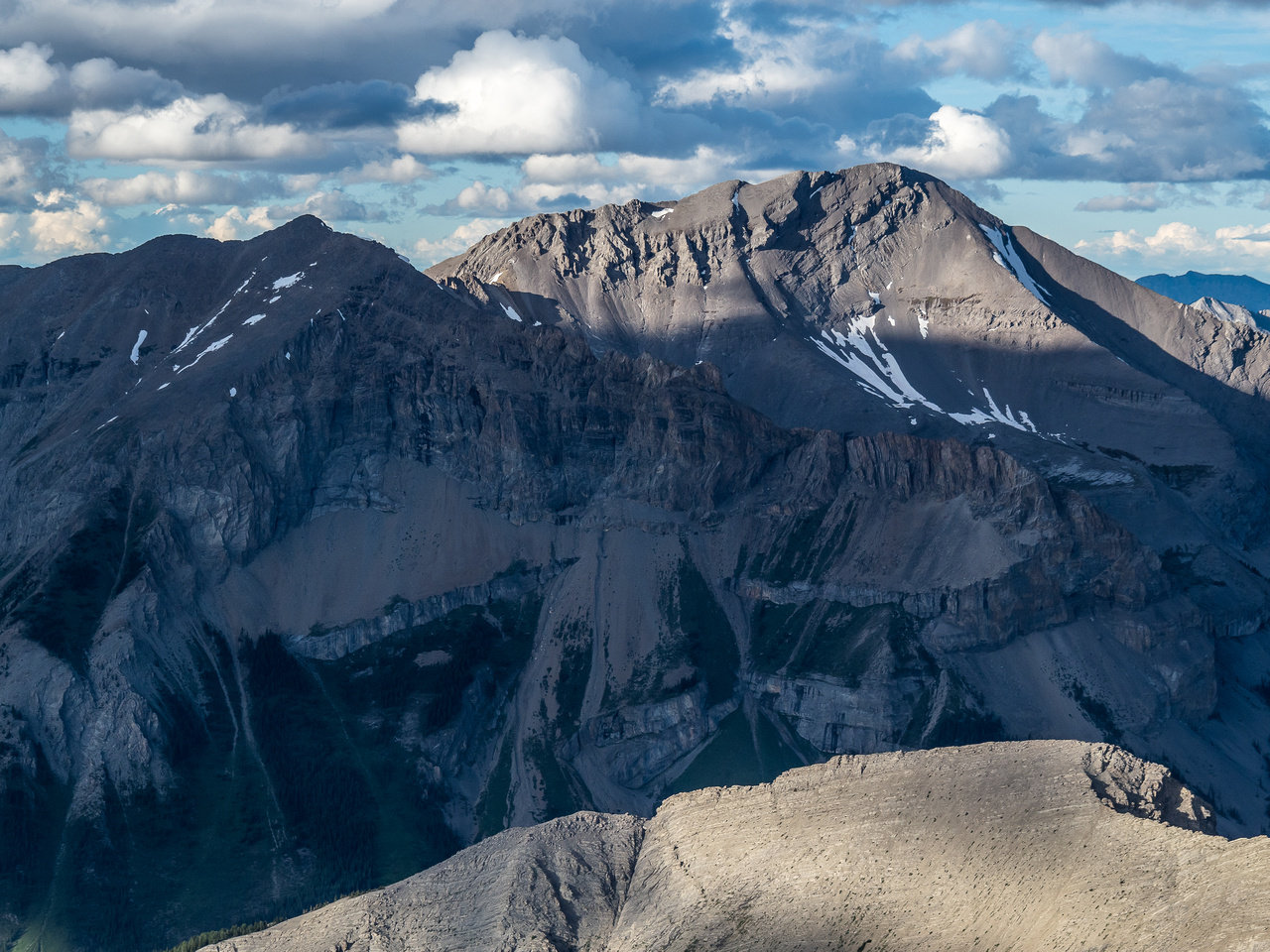 Nasswald Peak is named after Conrad Kain's birthplace in Austria. Golden Mountain in shadow at left.