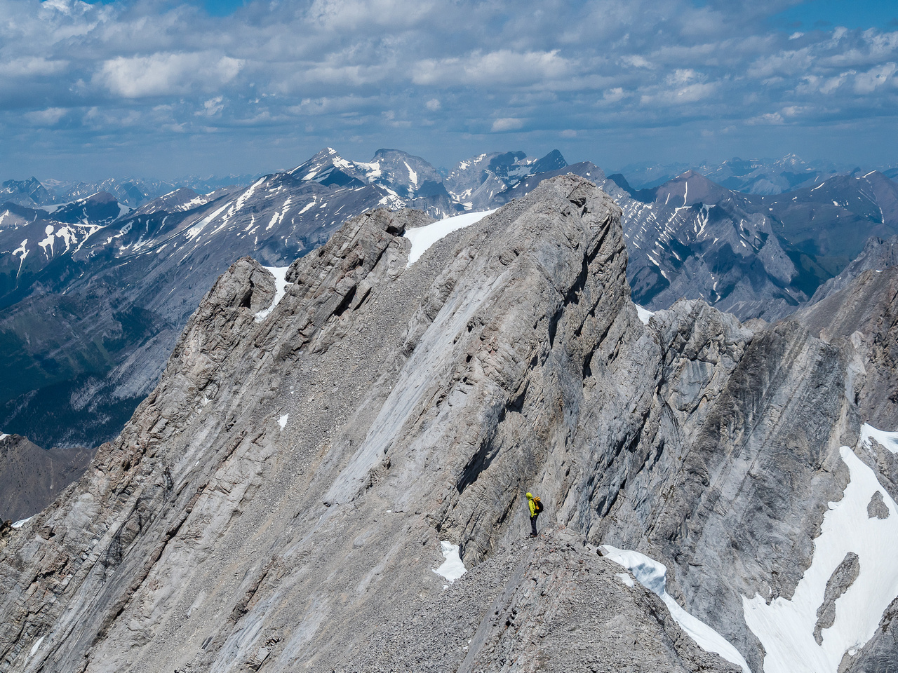 Wietse descends the very exposed ridge towards the north summit of Denny.