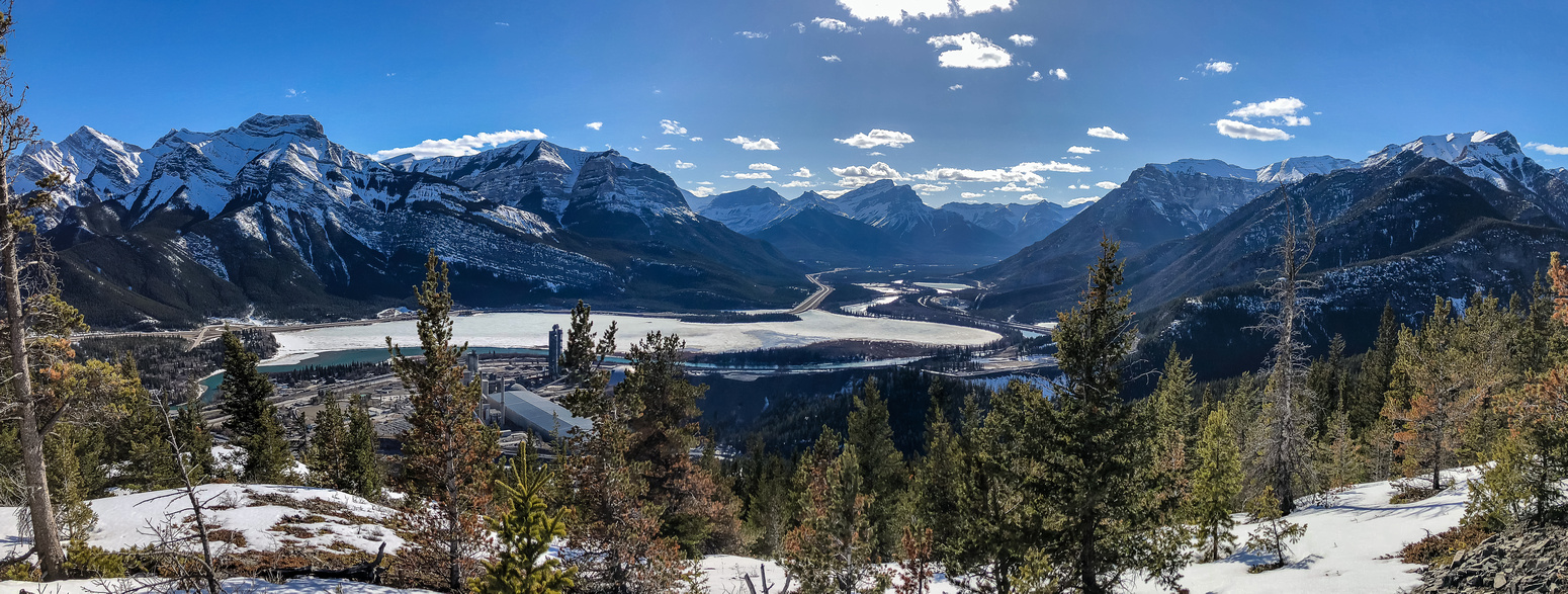 Looking over Lac des Arcs and up the Bow Valley towards Canmore with the Sisters, Grotto Mountain, Gap Mountain and Anklebiter Ridge at center and right.
