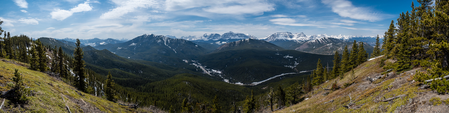 "Some decent views from the ""summit"" include Raspberry Ridge and Etherington Baril Ridge in the foreground with the High Rock Range in the distance."
