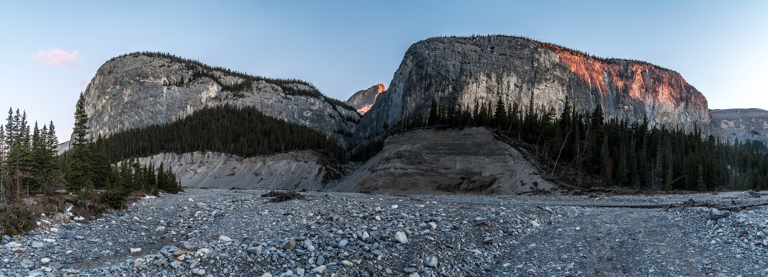 Sunrise on Devil's Head and cliffs along the Ghost River Trail.