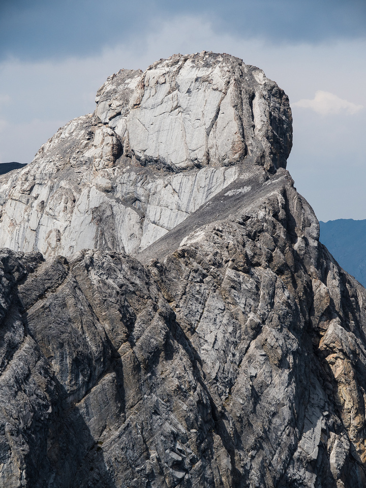 A close-up of Mythic Tower's summit block showing the crack and crux chimney which are key to cracking the summit.
