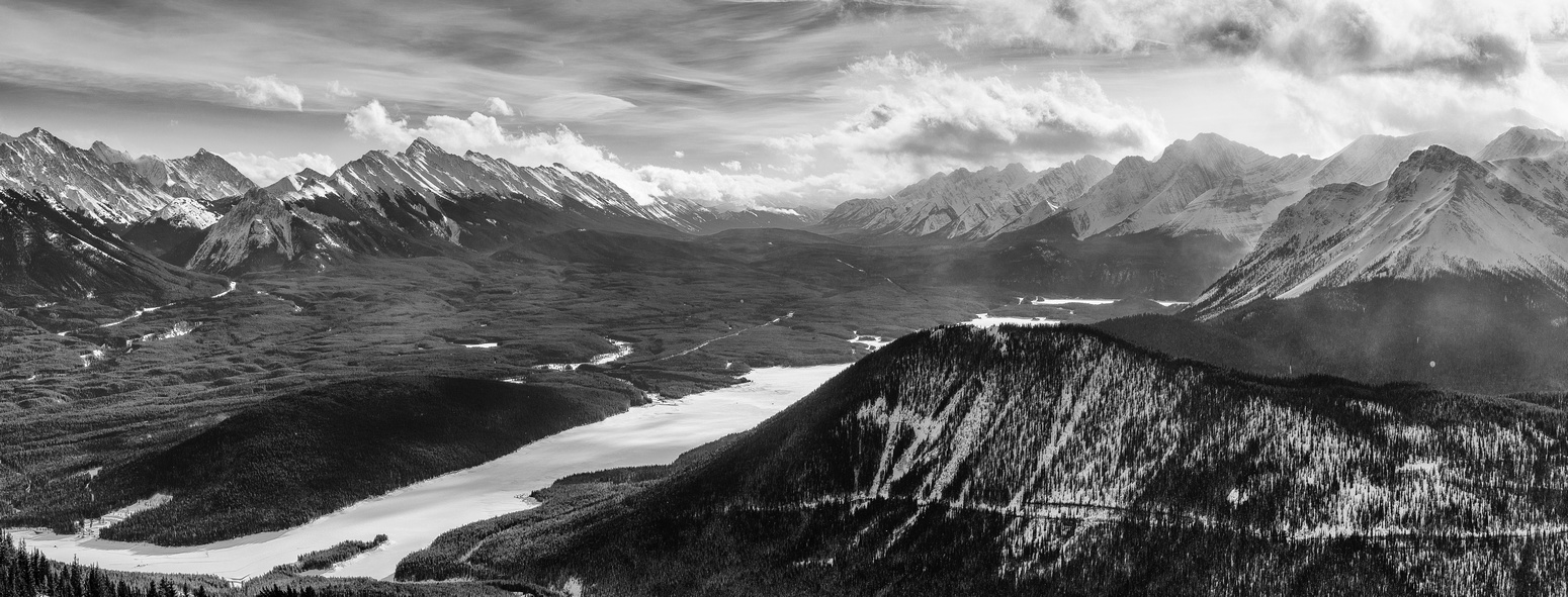 A wider view over the Lower Kananaskis Lake with the Elk Range at left looking through Elk Pass at center. At right are peaks such as Mount Fox and Indefatigable.