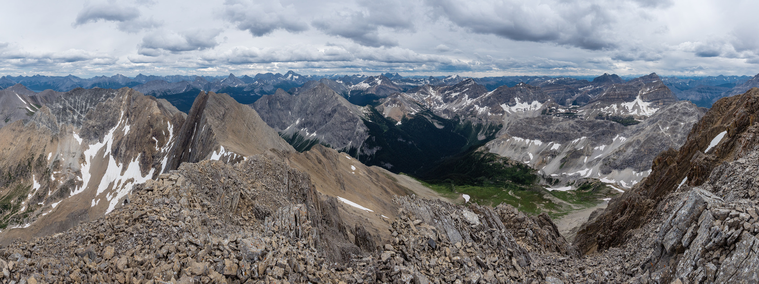 Looking over the Currie Creek drainage at center includes peaks such as (L to R), Morrison, Sir Douglas, Currie, Cross Ridge, White Man, King George, Talon, Soderholm, Red Man, Alcantara and Brussilof