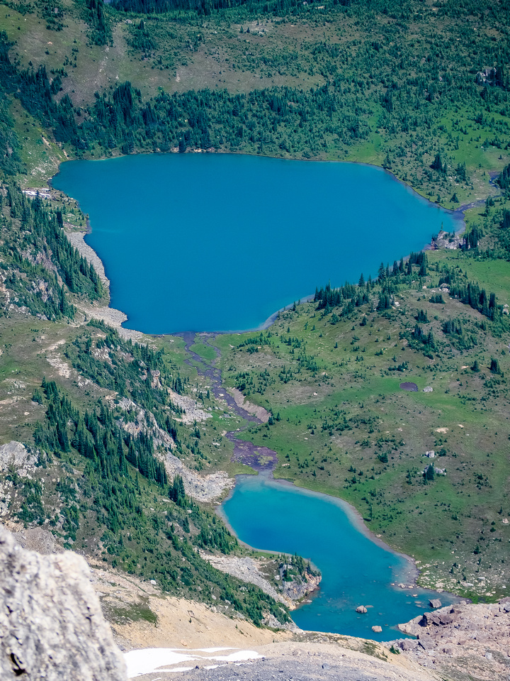These are just two of the many colorful tarns and ponds that line the Siffleur River Valley.