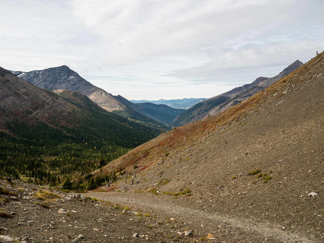 We briefly dropped over the pass before taking a trail in the scree going left.