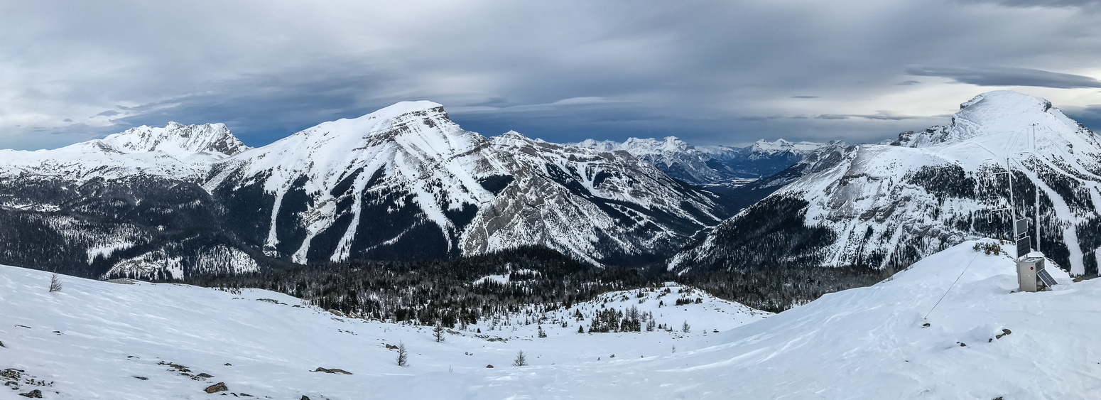 Mount Brett and Bourgeau at left with Healy Creek running up in the valley in the foreground and Eagle Mountain at right.