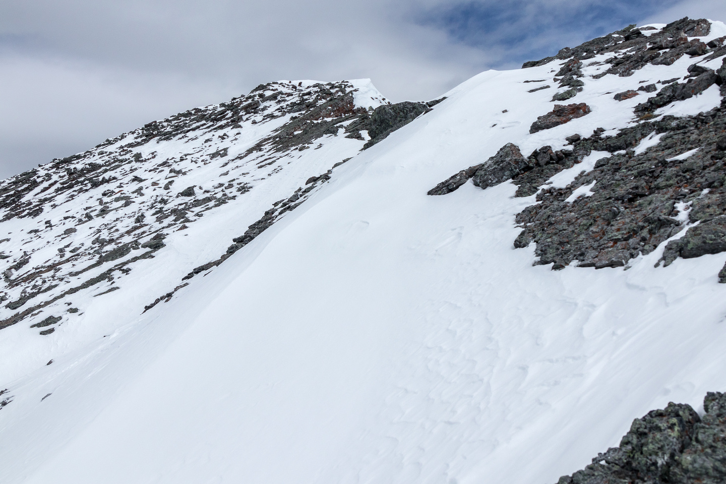 Some slabby snow to the summit.
