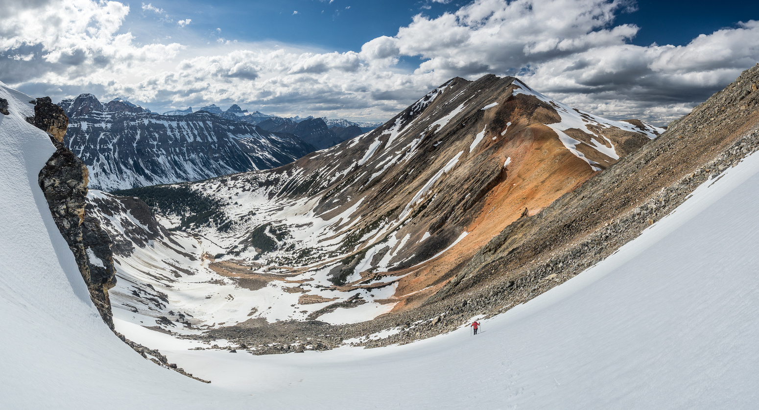 Looking back at Mike and Landslide Peak from the shallow couloir. Mount Hensley at left.