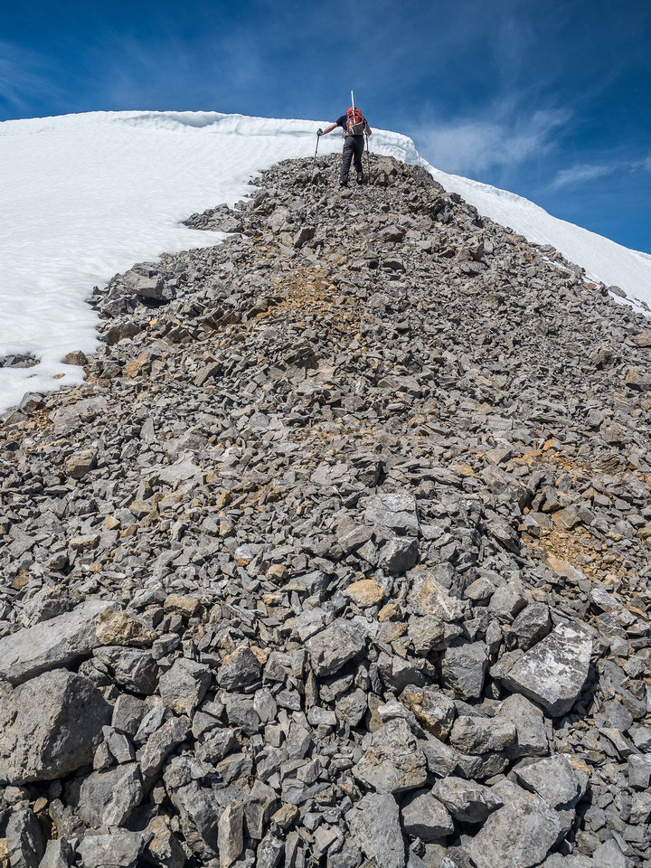The massive summit cornice wasn't an issue for mighty Mike.