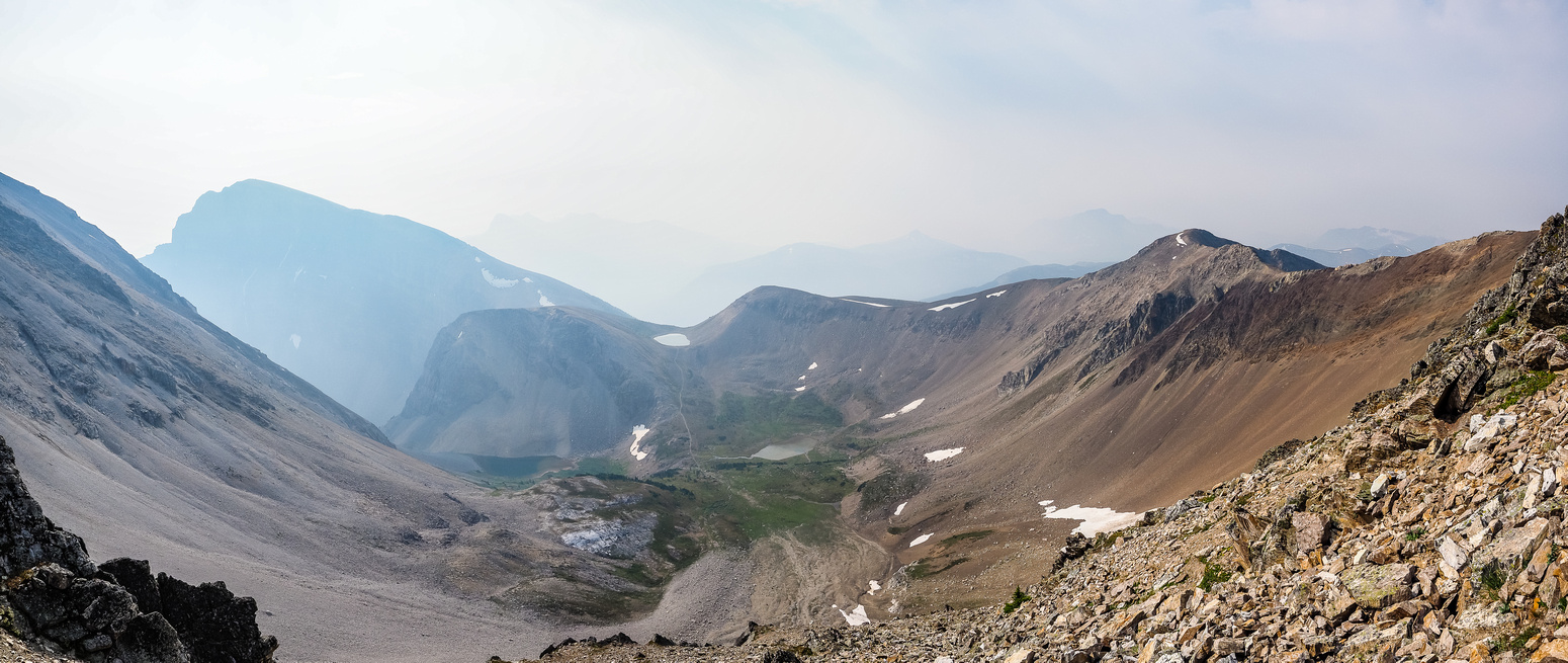 Nearing the col, looking back at Mount Bourgeau (L) with Harvey Pass left of center and the three Harvey Lakes barely visible in the smoke.
