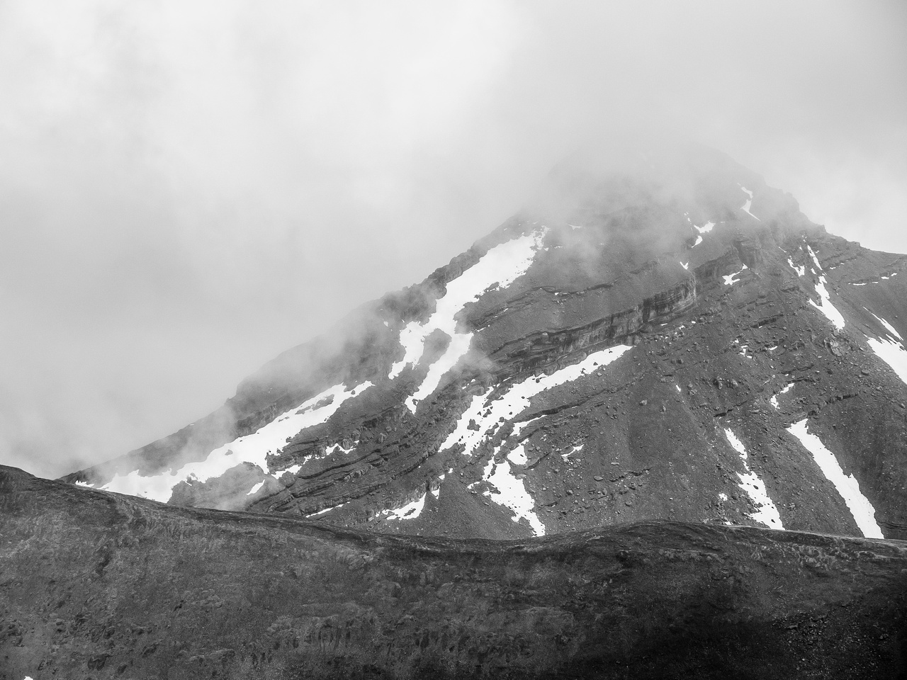The west ridge of Mount Bogart rises into the clouds.