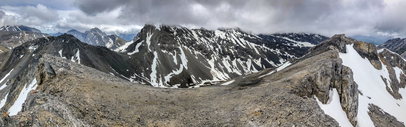 A panorama looking east (L) and south includes Mount Kidd, Kidd South, Guinn's Pass and Lillian Peak (L to R).