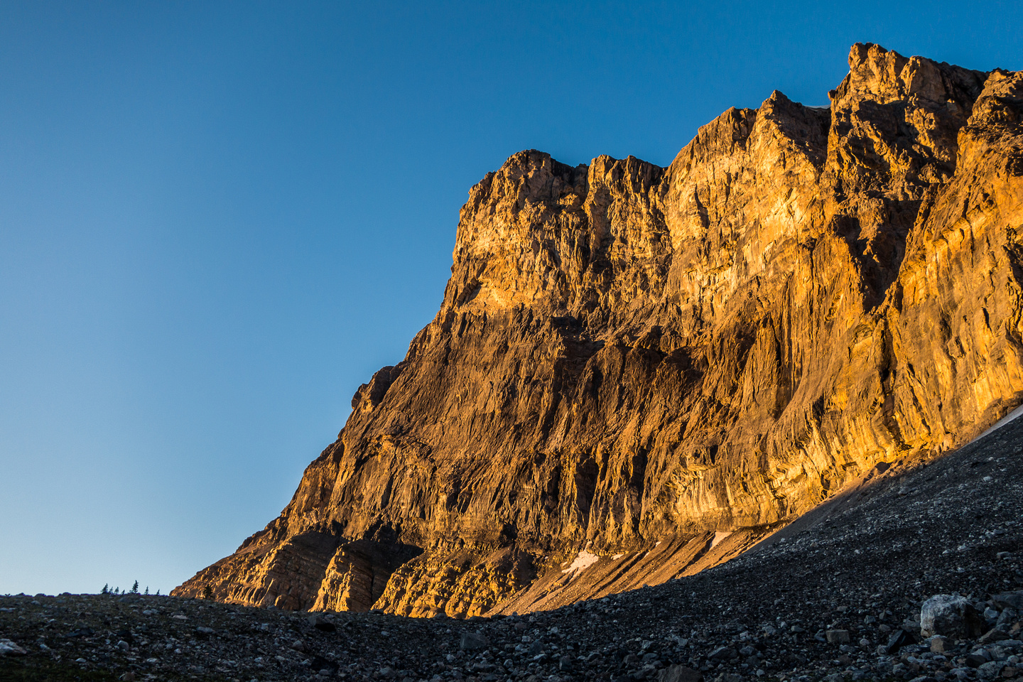 Warm sunrise on the cliffs above the approach traverse.