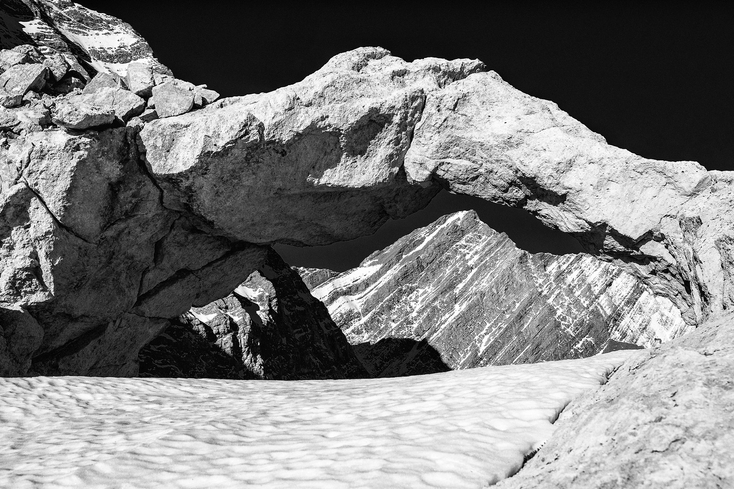 One of Pyriform's outliers through the small rock arch near the col.