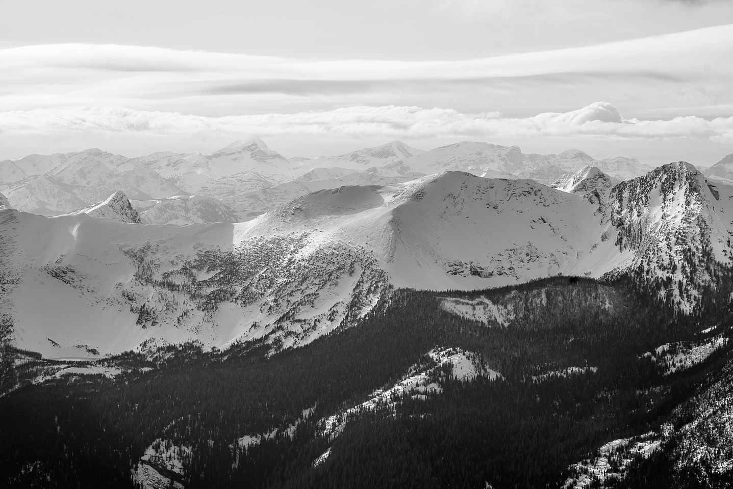 """Looking over Three Lakes Ridge, and Mount Miles to the west. """"RA"""" at left."""