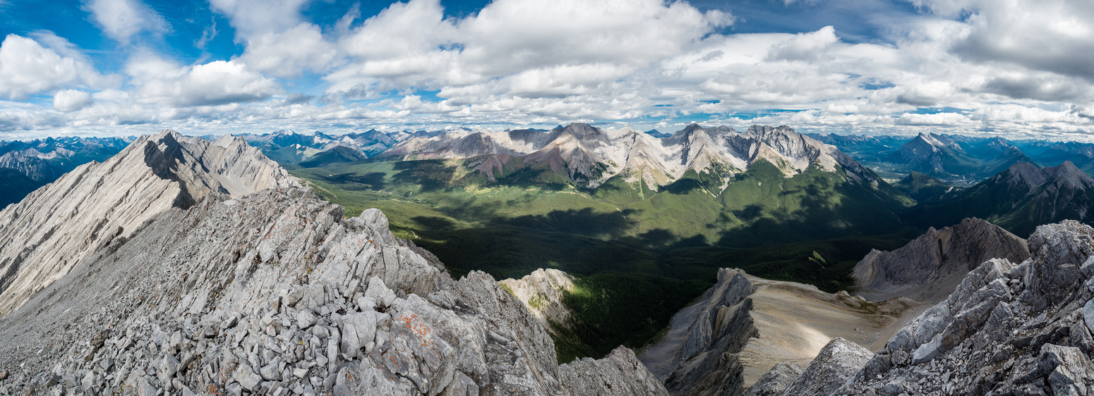 Elk Lake Pass at lower left and the huge Cascade Mountain massif filling the horizon. Mount Rundle and the town of Banff at far right.