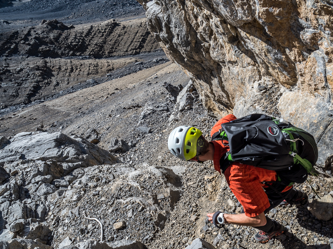 Navigating the loose gully that breaks through the lower cliff band.