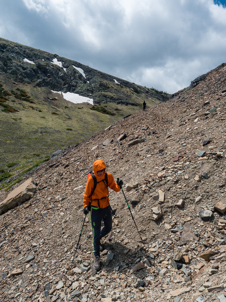 It's still a chilly wind as we descend the loose scree trail.