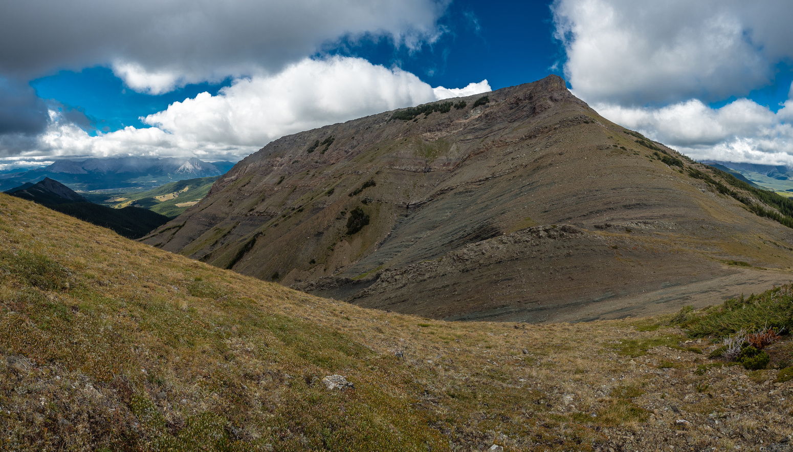 Starting down the easy west side of McGillivray Ridge, headed to the symmetrical form of Ma Butte.