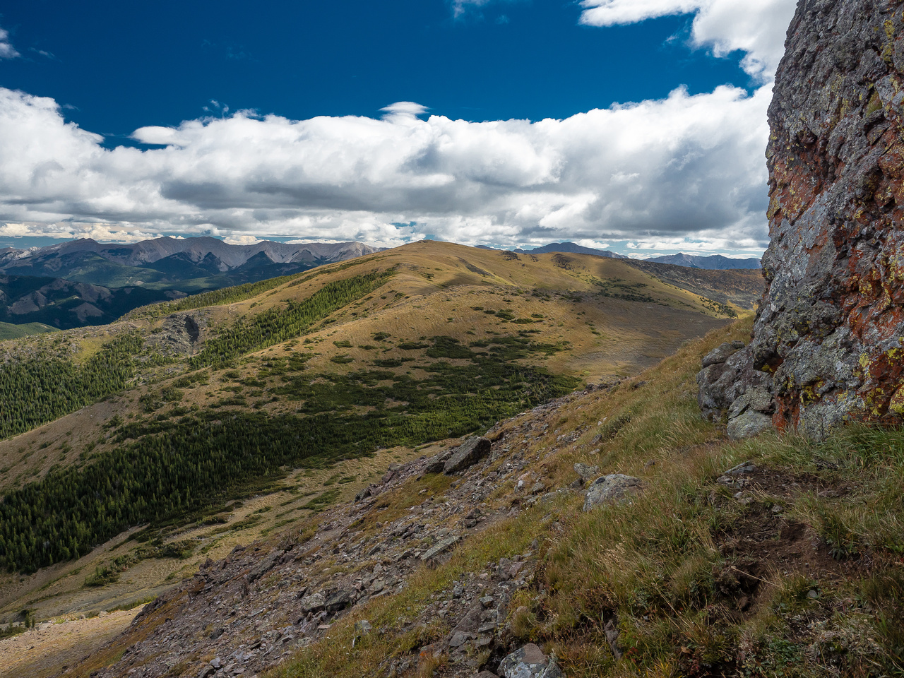 Looking back at McGillivray Ridge from under the summit block of Ma Butte.
