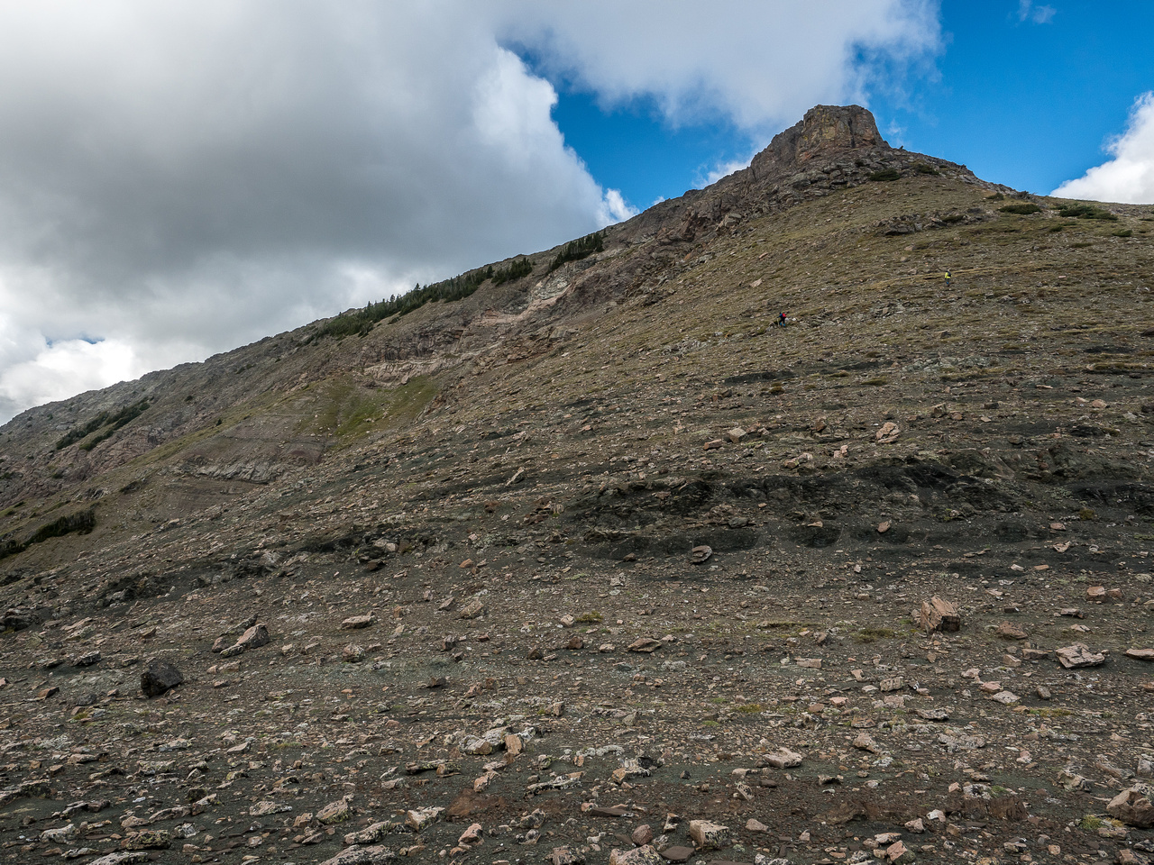 Looking up at several hundred meters to the summit of Ma Butte from the col.