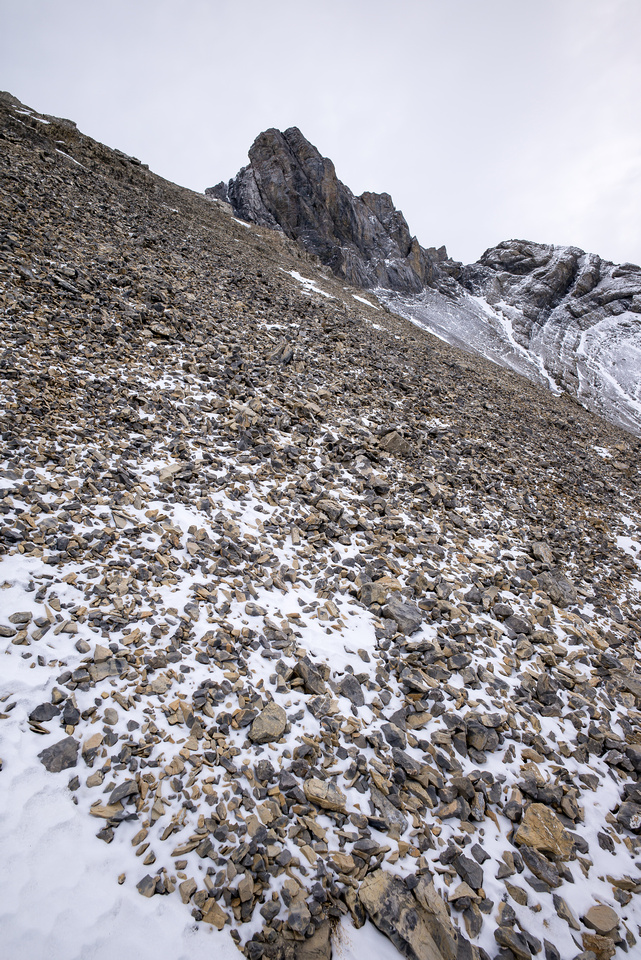 Scree slopes and the summit block up ahead. The ridge we should have stuck to is oos on the left.