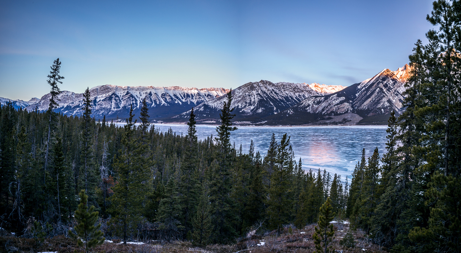 Gaining the lower NW ridge of Michener, looking back at Abraham Lake towards Vision Quest and Coral Ridge.