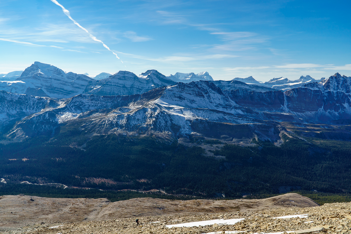 Robin is dwarfed by the huge terrain. Sunwapta on the L, Alberta at center and GEC at R.