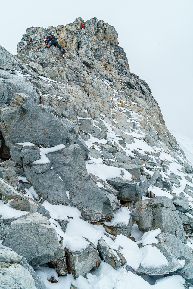 This view of Ben down climbing and the climber on the crux gives a better insight to the terrain on the northeast ridge