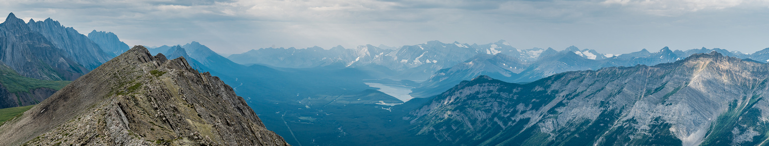 Another pano of the view to the south, showing the Lower Kananaskis Lake in the far distance and even Joffre through the haze.