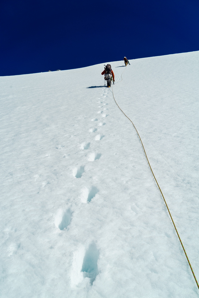 A steep snow climb on slurpee snow - sometimes sinking to knee deep without the snowshoes on.