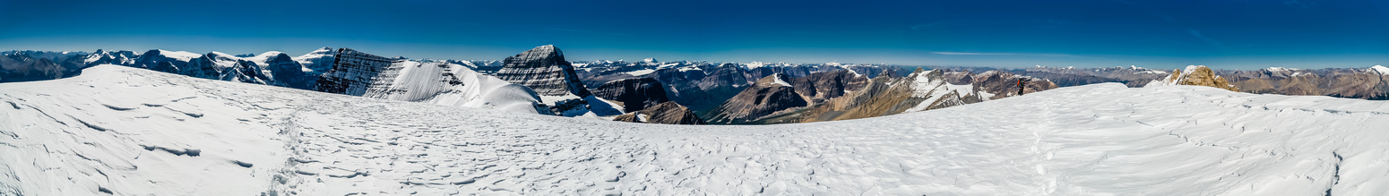 A panorama from what the majority of climbers consider the summit of Diadem Peak. The slightly higher - and much more difficult - rocky summit at right.