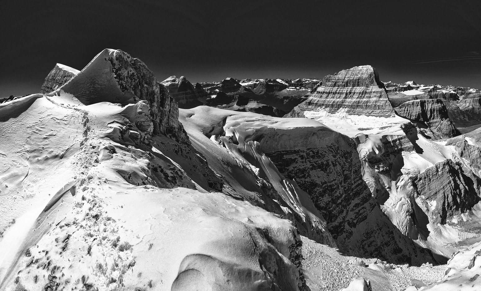 Dips and curves on the north ridge of Woolley and dizzying exposure down the west face towards Mount Alberta and it's north face.