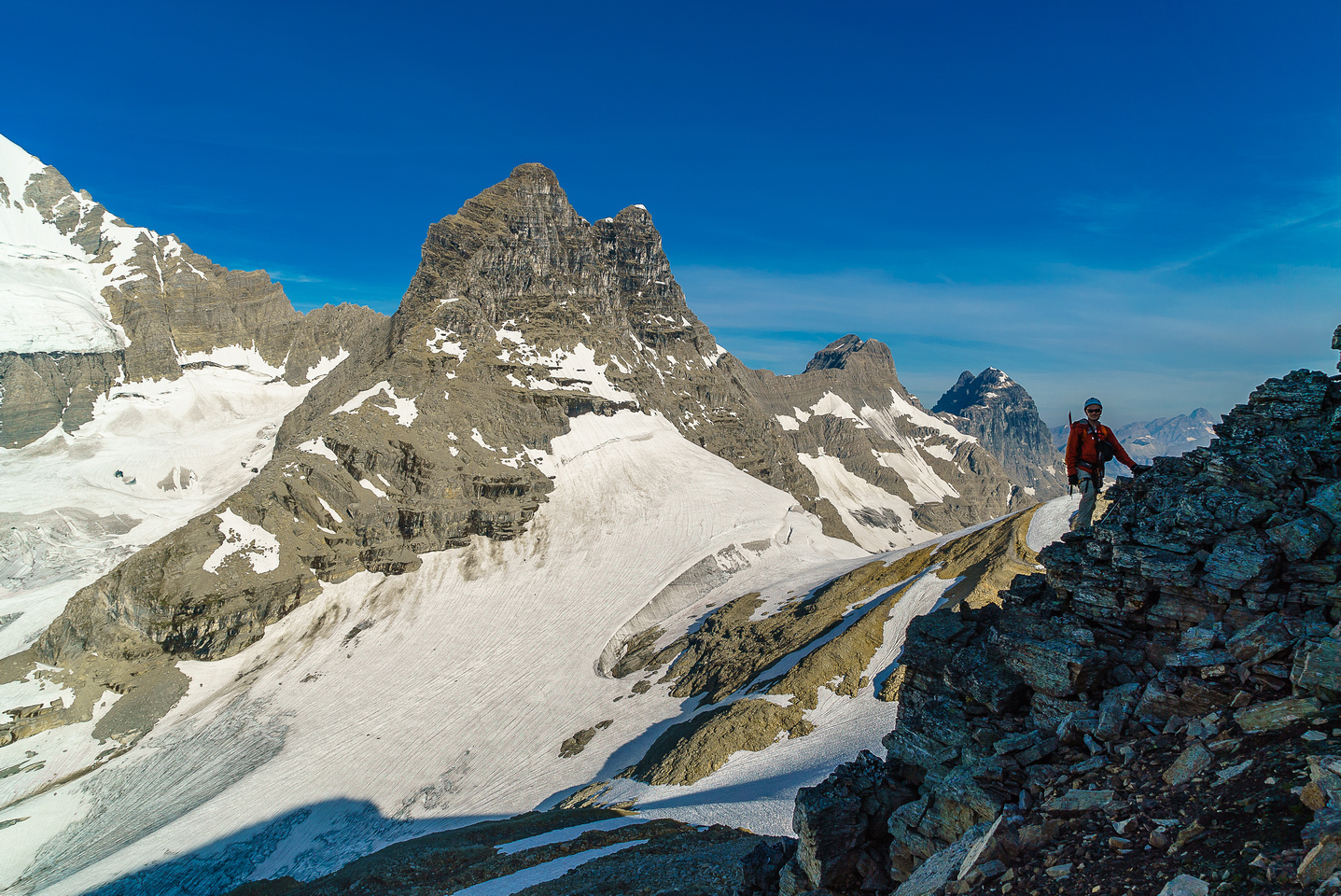 Ben climbs above the snow with the impressive summits of Prince Henry, Prince John and Queen Mary in the background