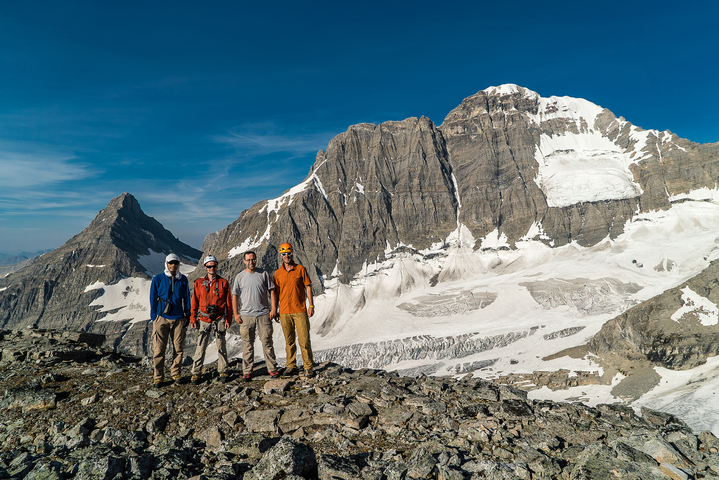 The gang with our previous days summits in the background.