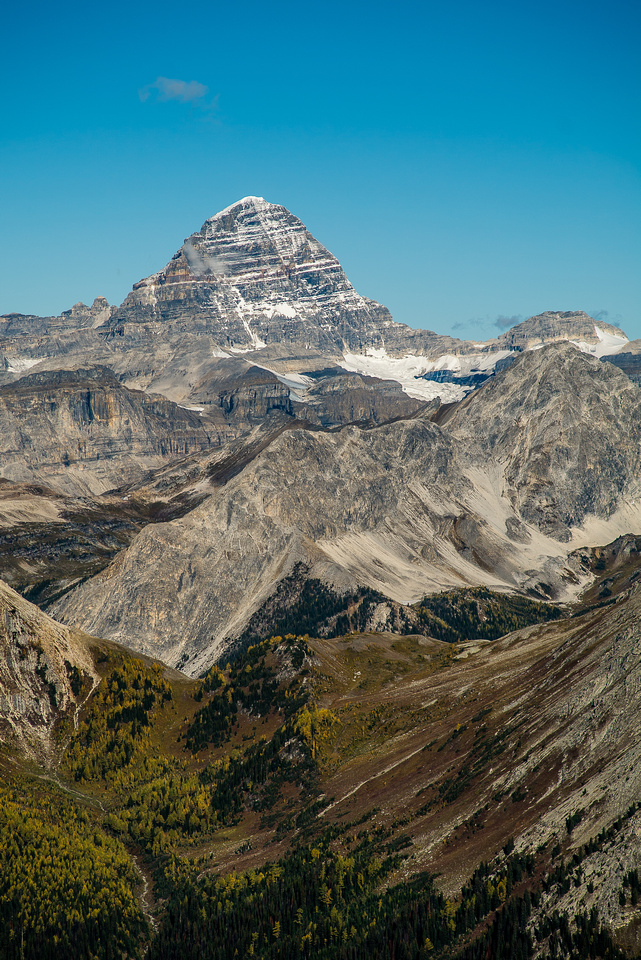 The mighty Mount Assiniboine looms over Mount Gloria.